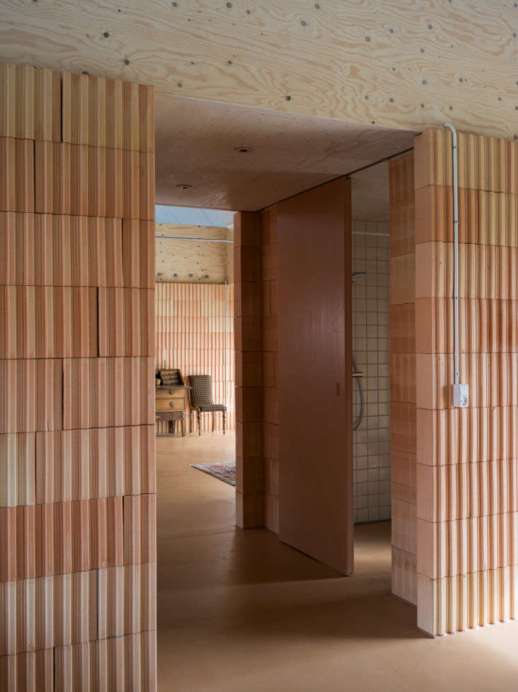 sliding doors made of red mdf boards were chosen in lieu of standard hinged doo 15