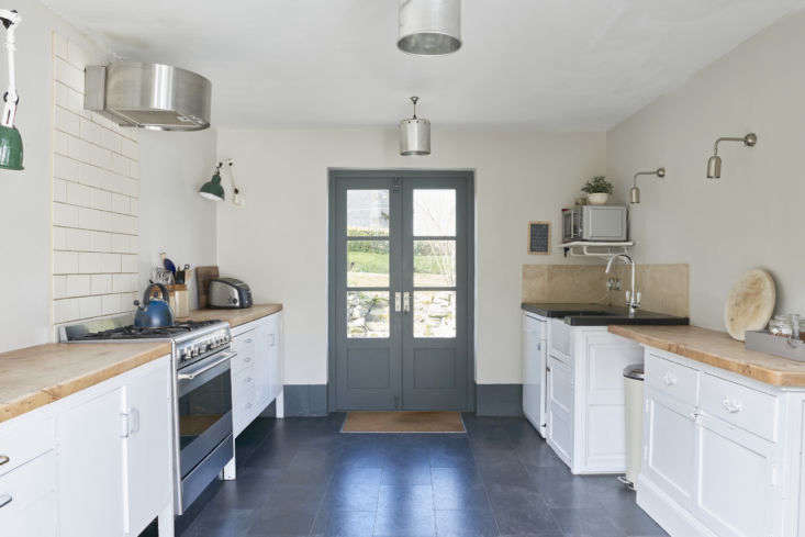 The kitchen, housed in an extension that was added in the late 70s, is completely freestanding. &#8