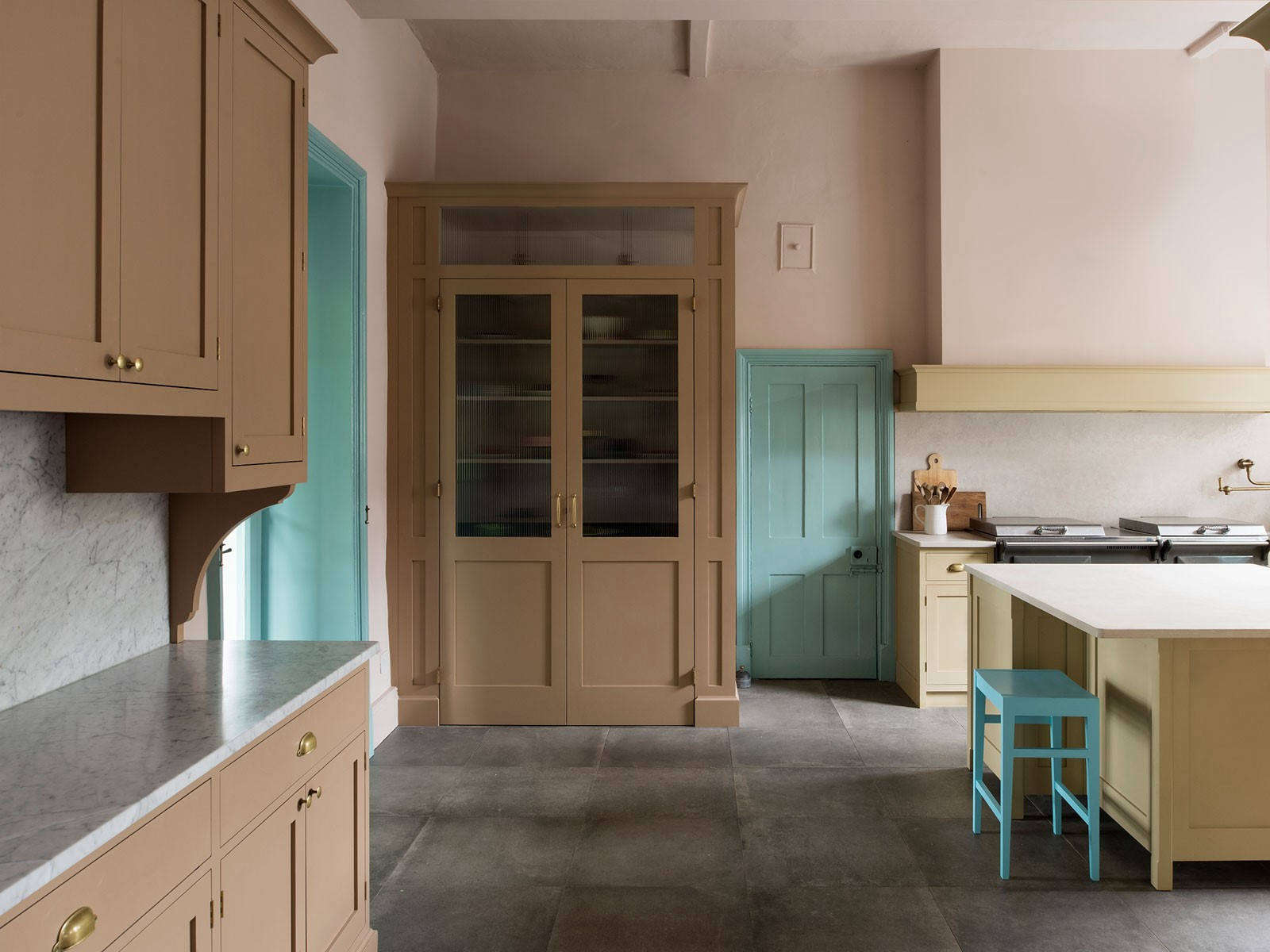 The kitchen includes a large larder and sideboard painted in drab brown. Photography byLeigh Simpson, courtesy of Inglis Hall from Kitchen of the Week: An Unexpected Palette in a Custom Kitchen Designed by Inglis Hall.