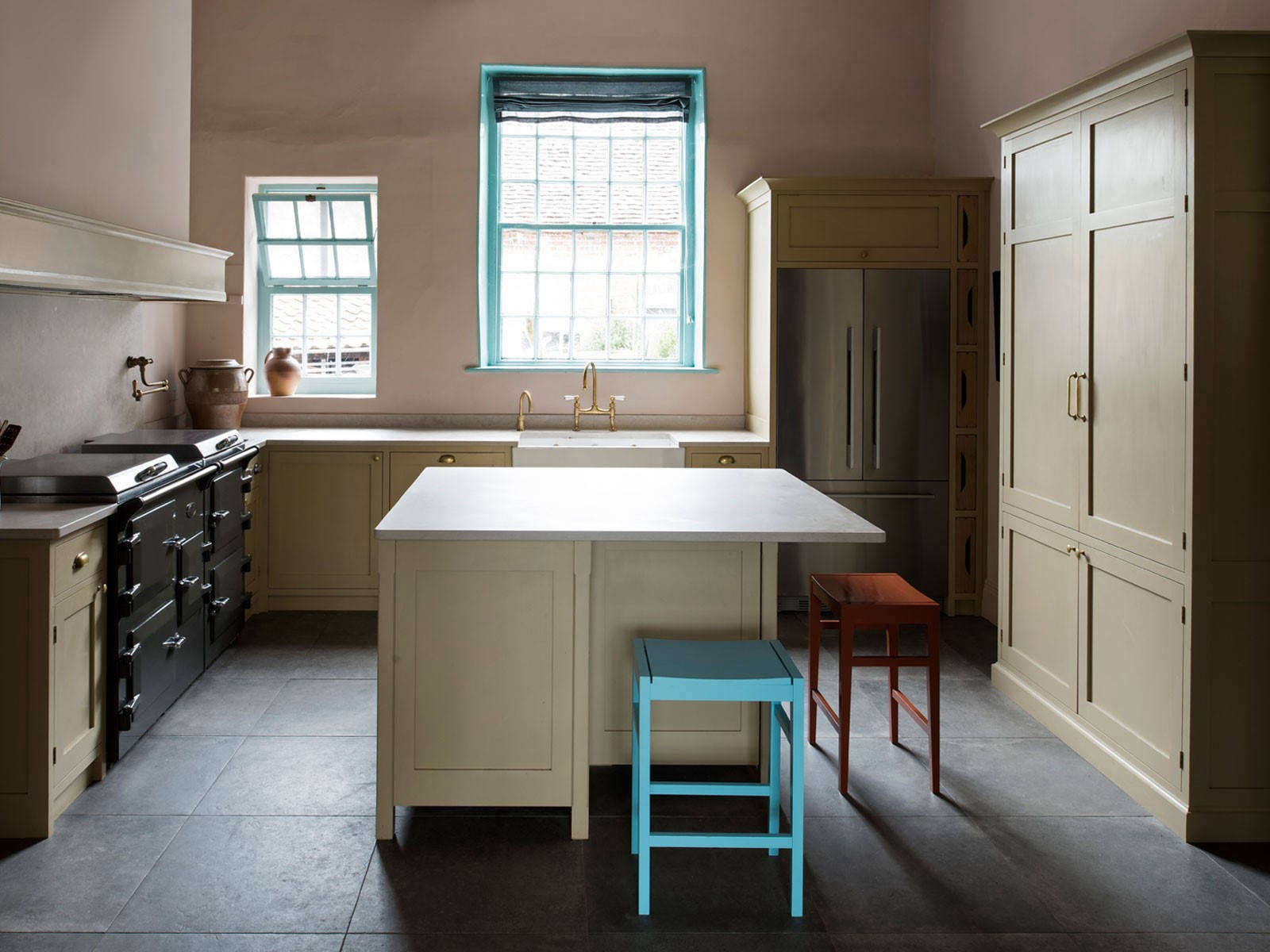 Shades of brown are offset with bright turquoise green paint. Photography byLeigh Simpson, courtesy of Inglis Hall from Kitchen of the Week: An Unexpected Palette in a Custom Kitchen Designed by Inglis Hall.