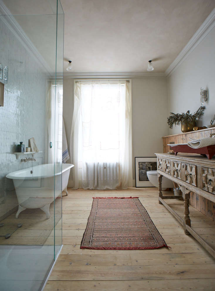 Centuries and styles mix in the master bath. The tub was in the house, &#8