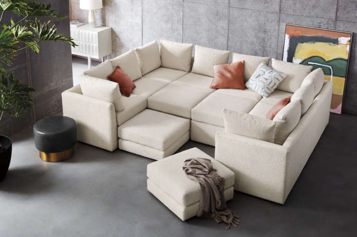 The Dr. Pitt Seven-Piece Sectional Sofa, pictured here in a soft Sherpa upholstery, is completely modular and can be pulled apart or pushed together to create different configurations. You can also design a sectional of any size to suit your space.