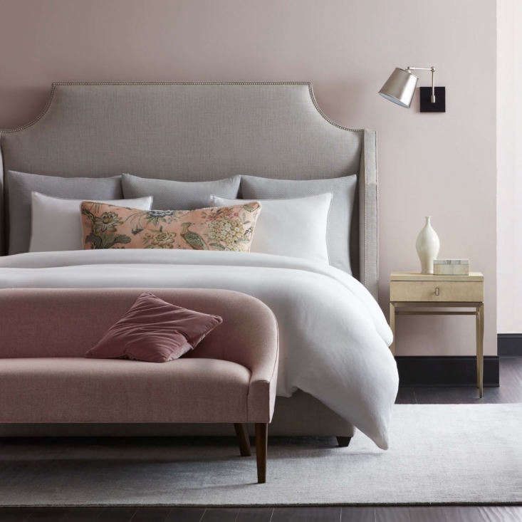 Comfort and aesthetics meet in the Mirabelle Bedwith upholstered headboard, dressed here in the company's Harmony bed linens. At the foot of the bed is the Bella Bedroom Sofa in blush Sunbrella fabric.