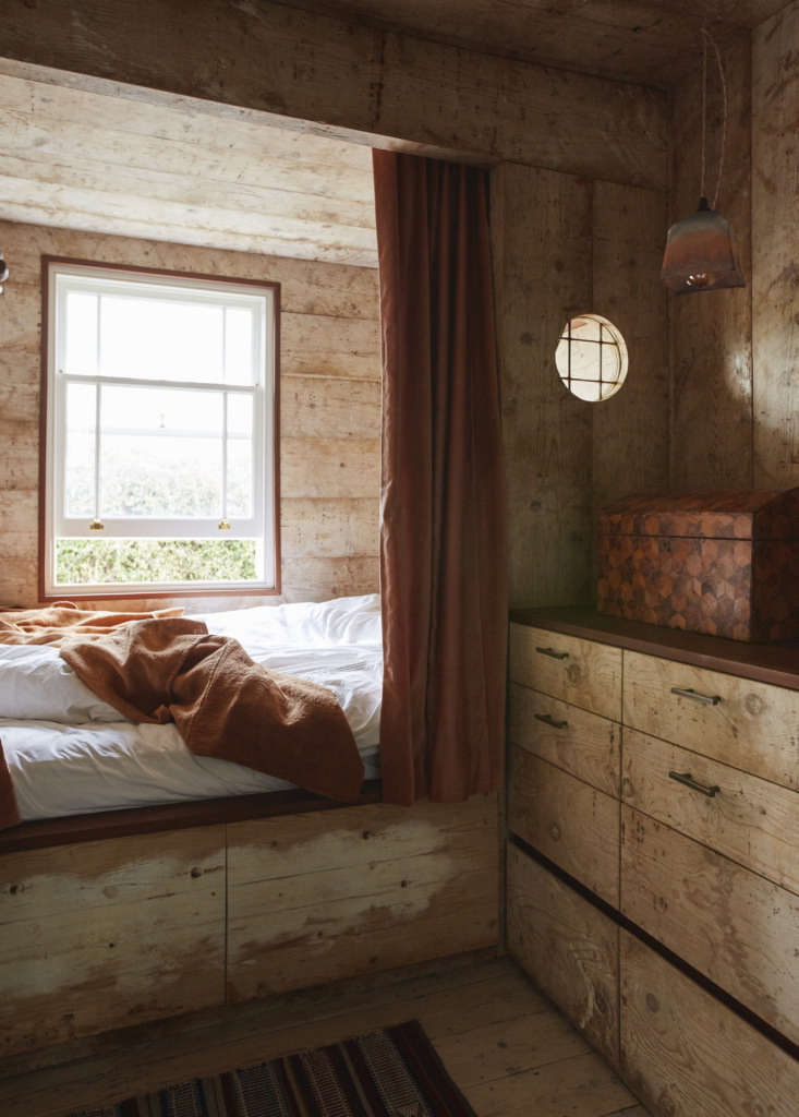 The room has a built-in dresser and, just out of the photo, a compact sink from an old train car.
