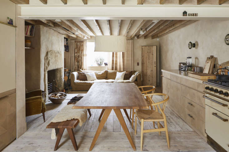 The lounge opens to the dining area and kitchen, which references the costumier&#8