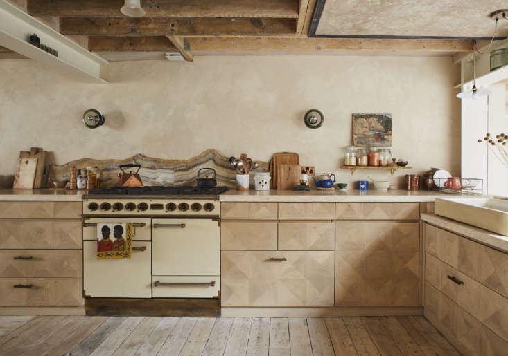 The cabinets are faced with th century marquetry floorboards that came out of a building in Vienna. The backsplash is made of slices of onyx that Adam bought from a fireplace and sculpture restorer who was retiring.