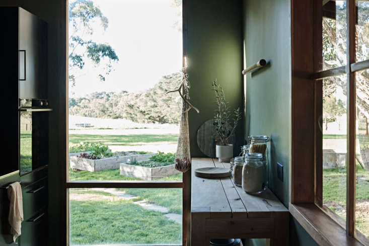 A glimpse into the green from A Young Australian Designer's Inventive Cabin Makeover, Ikea Upgrade Included. Photograph by Lachlan Moore, courtesy of Studio Moore and Ross Farm.
