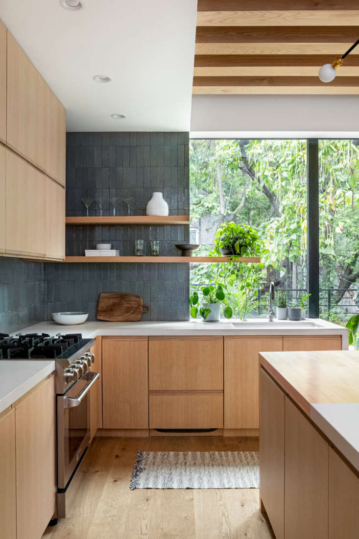 The counters are Caesarstone in a color aptly called Fresh Concrete. The cabinets were designed to be &#8