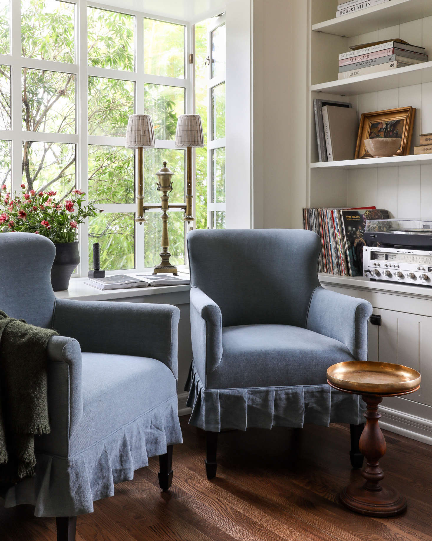 Tailored granny chic: Caillier designed skirted armchairs for the music corner of the room.
