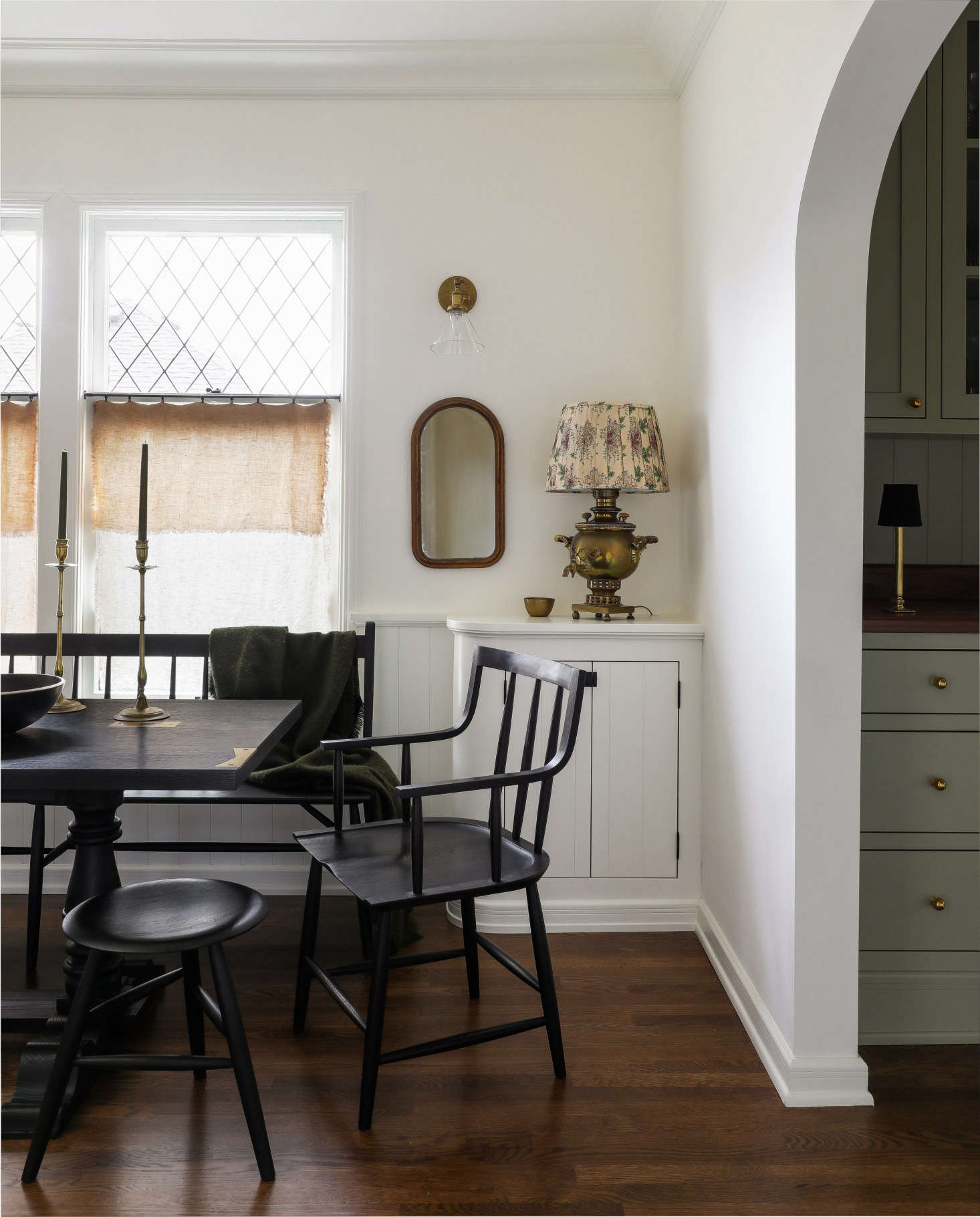 The dining table and chairs are Sawkille designs: the Springsteen Trestle Table, Senate Chair, and Dinner Stool.
