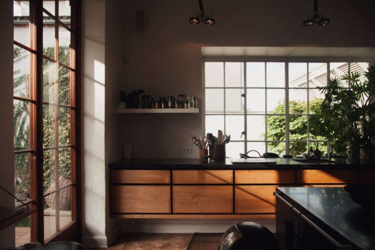The Garde Hvalsøe kitchen with floating Dinesen wood cabinets and a slate counter.
