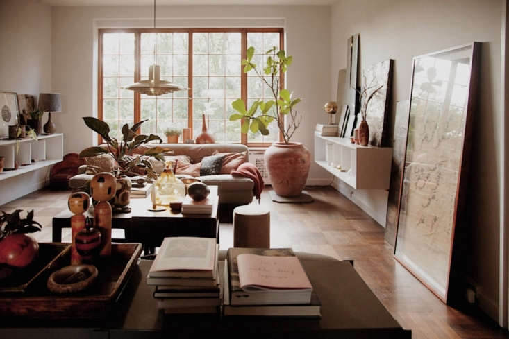 A glimpse of the long living room, which enjoys ample natural light from the oversized steel windows.