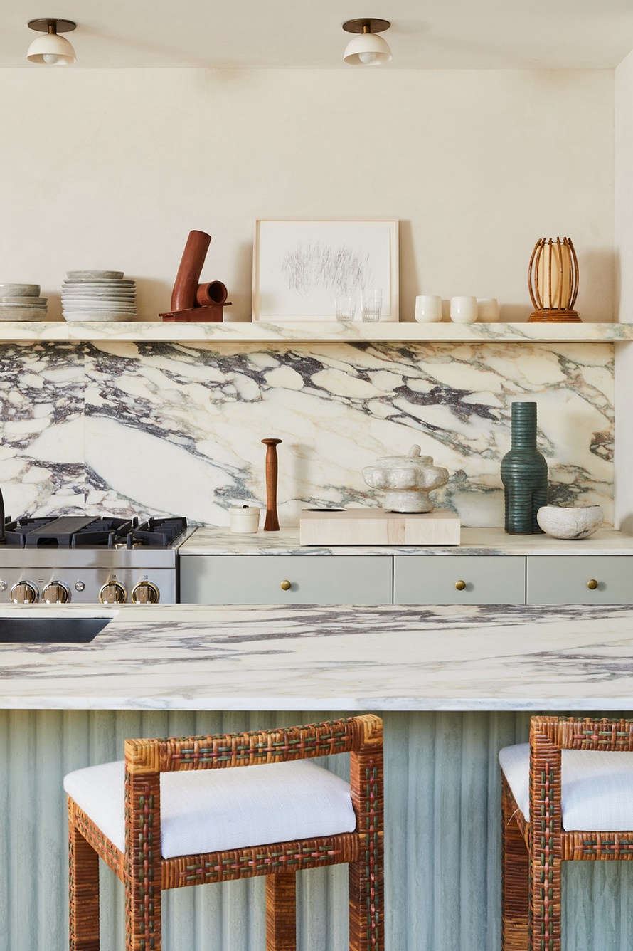 Interior designer/chef Athena Calderone is especially at home in the kitchen: her Amagansett house features this marble-topped island detailed with custom plaster fluting by Kamp Studios (see below). Check out Calderone&#8