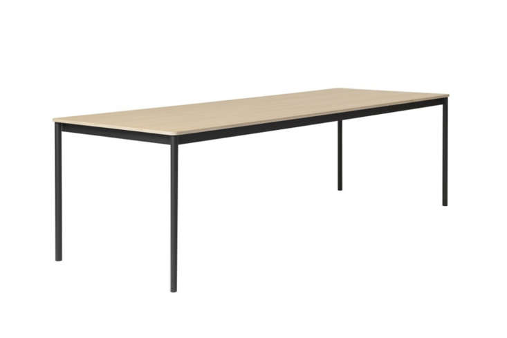 The Muuto Rectangle Base Table, shown in Oak Black, starts at $976.65 at the Danish Design Store.