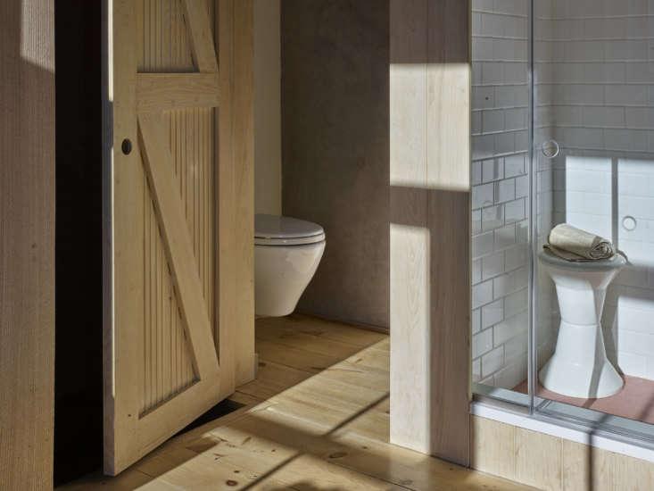 The WC has a custom barn door: &#8