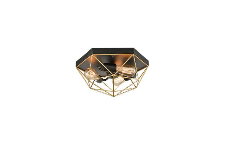 Another of Claxy's best-selling ceiling lights—the geometric Metal Caged Flush Mount Ceiling Light ($99)—features a semigloss black base and shimmery brass cage. (It's also fully dimmable when paired with a dimmer switch.)