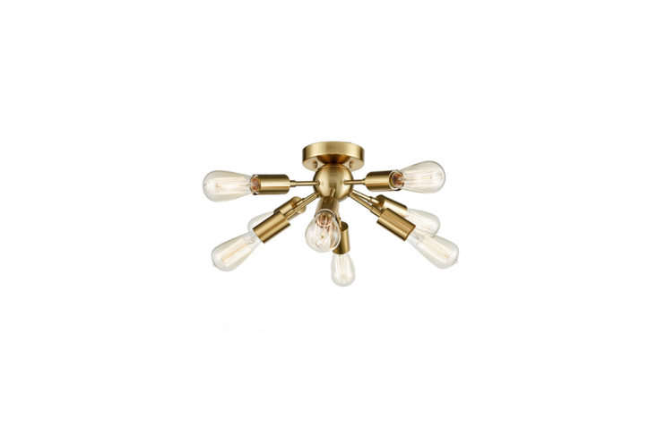 The Modern Sputnik Flush-Mount Fixture ($96.88), shown here in warm brass, is also available in brushed nickel and oil-rubbed bronze.