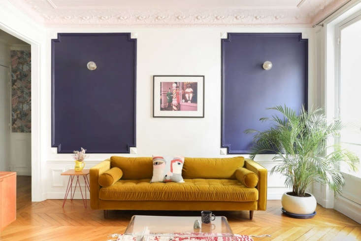 A Classic Paris Apartment Gets a ColorBlocked Update for Two Graphic Designers  &#8\2\20;We approached this design like a graphic designer would do: with compositions of color and pattern,&#8\2\2\1; Hélène tells us. The living room was given a new guise by calling out the picture frame moldings in a deep blue violet from French line PaperMint.