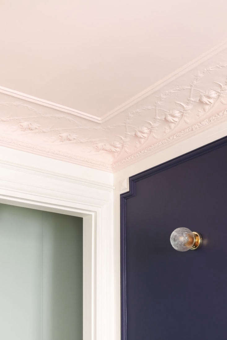 A Classic Paris Apartment Gets a ColorBlocked Update for Two Graphic Designers The ceiling is edged with floral plasterwork cornices that verge on Art Nouveau, all now painted in Heju&#8\2\17;s go to Middleton Pink by Farrow & Ball.