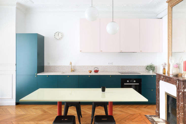 A Classic Paris Apartment Gets a ColorBlocked Update for Two Graphic Designers The room&#8\2\17;s original red marble fireplace and gilded mirror now stand against a color blocked kitchen. &#8\2\20;We designed the room as a graphic composition between vertical and horizontal rectangles,&#8\2\2\1; says Julien.&#8\2\2\1;We chose to use the same light pink as the living room ceiling, then we tried dark colors that contrast with it, and liked the way this green looks against the pink and terra cotta.&#8\2\2\1;