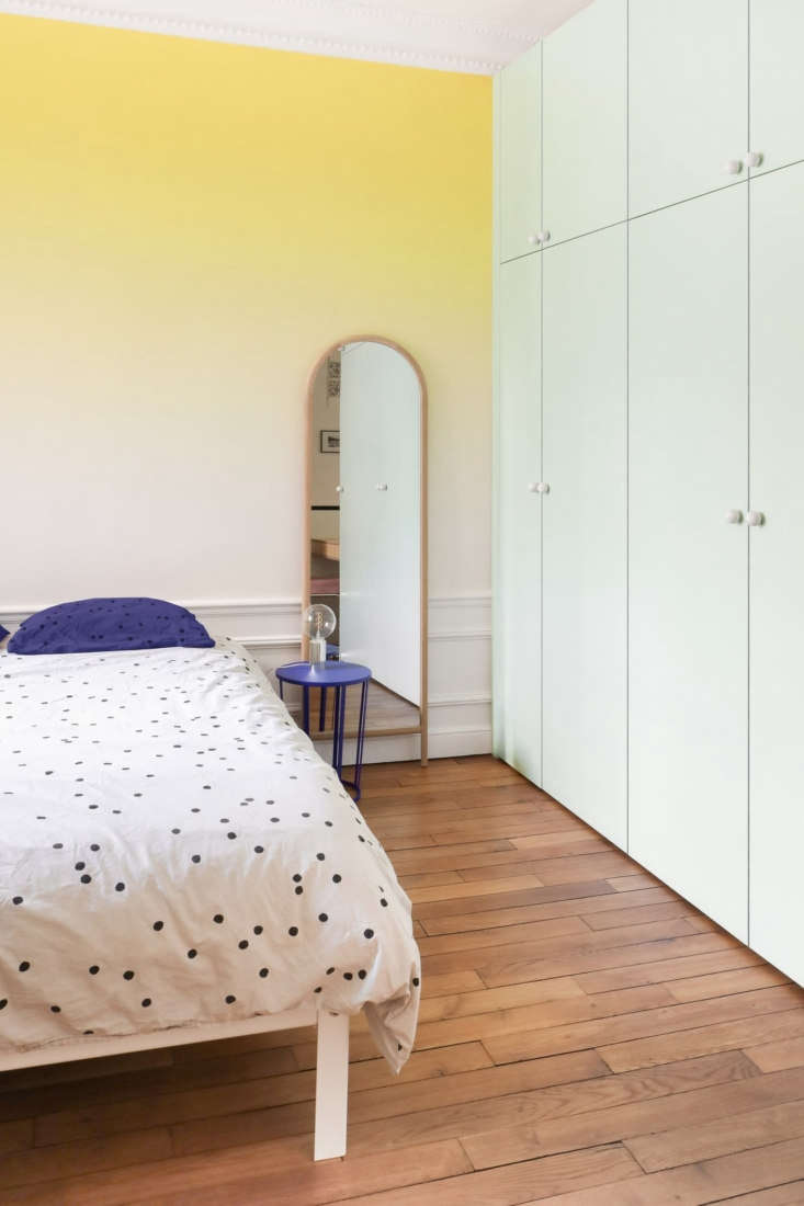 The master bedroom is cloaked in an ombre palette courtesy of Sunset wallpaper from Bien Fait. The architects&#8
