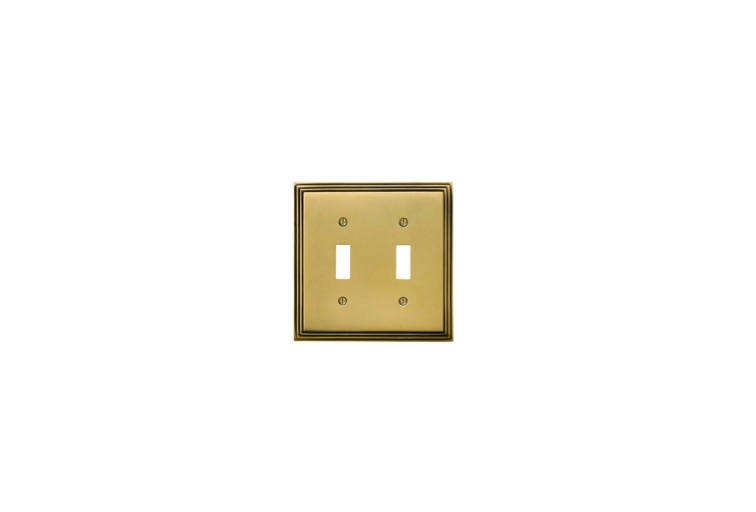Brass details, like the switch plates the couple found on House of Antique Hardware&#8