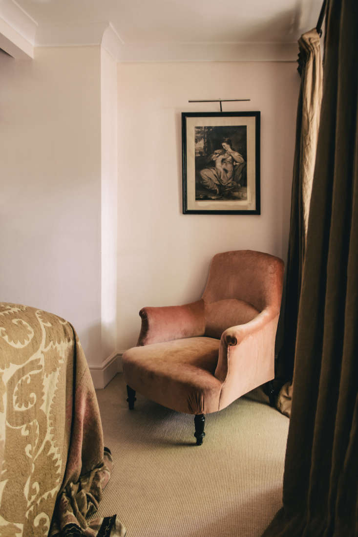 A suzani from Istanbul and a dusky rose upholstered armchair add to the softness in the room.