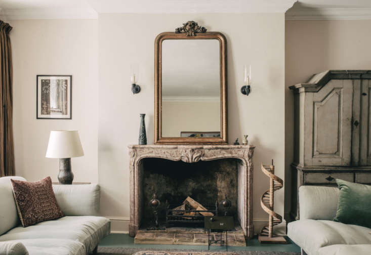 The interior color scheme—muted jade and pale pink—was inspired by the th century fireplace sourced in Belgium. &#8