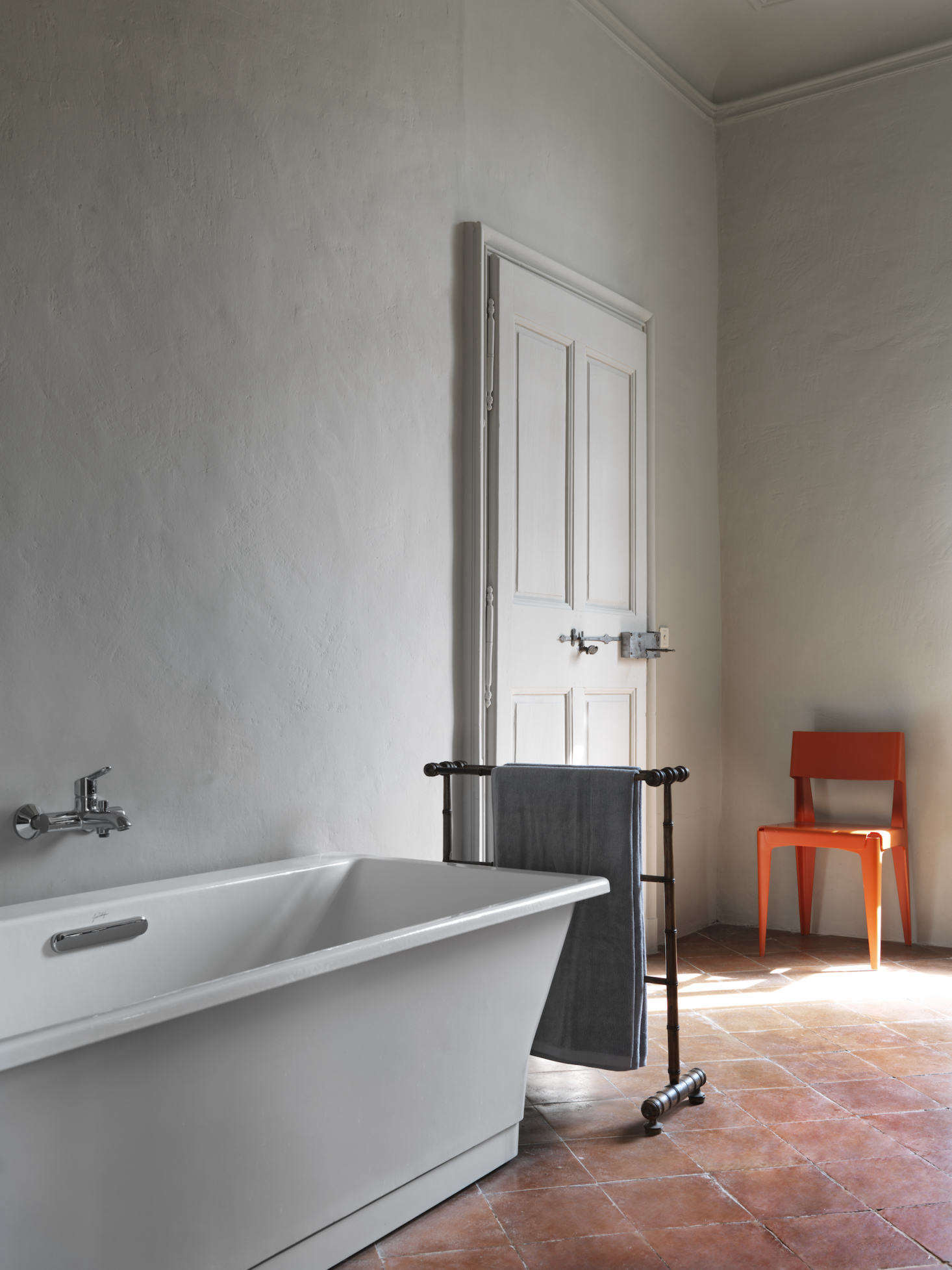 The bathtub is from Jacob Delafon in Paris; the plywood chair is by Barber & Osgerby for Isokon Plus.