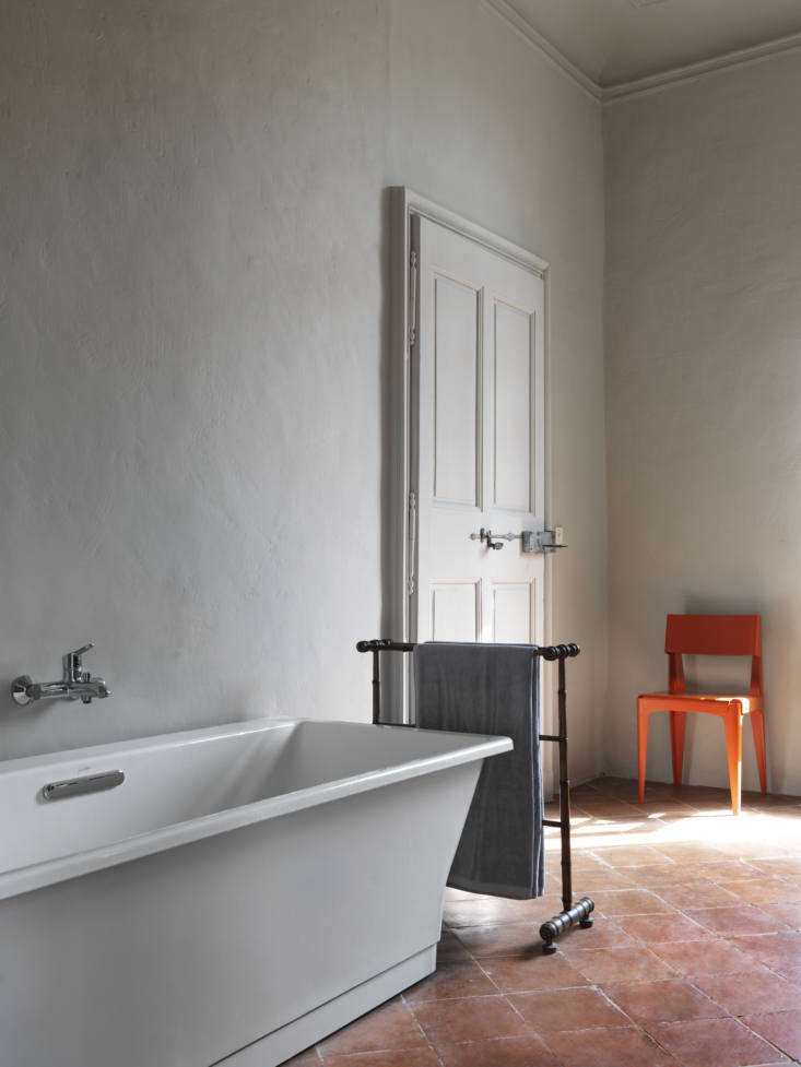 Second Act A London Design Couples Townhouse in a Small French Market Town The bathtub is from Jacob Delafon in Paris; the plywood chair is by Barber & Osgerby for Isokon Plus.