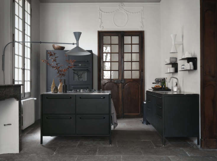 Second Act A London Design Couples Townhouse in a Small French Market Town Three Vipp modules make up the kitchen. The legs can be adjusted, a useful feature when you&#8\2\17;re dealing with an uneven 700 year old stone floor. The two lights are by Le Corbusier.