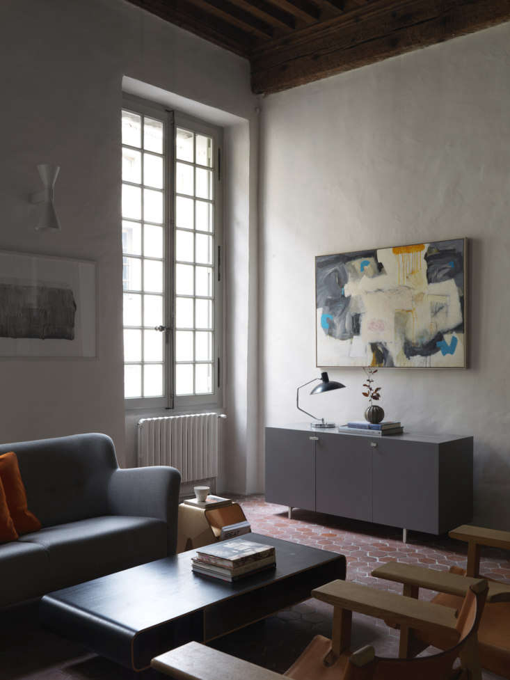 Second Act A London Design Couples Townhouse in a Small French Market Town Several of the pieces in the living room are from Isokon Plus, including the Barber & Osgerby Loop Coffee Table and a custom side table.