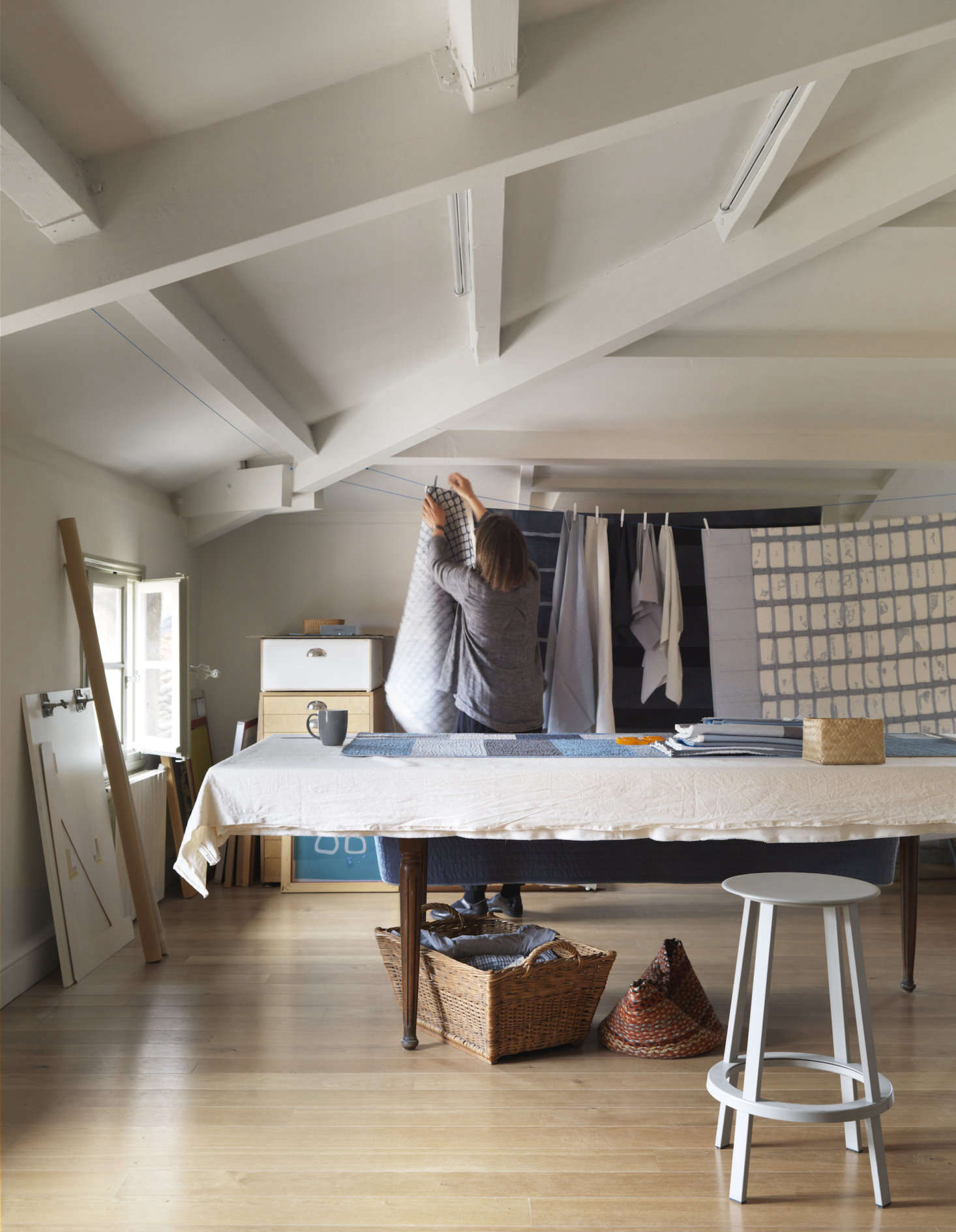 The couple have side-by-side studios (his for guitar-crafting, hers for textile-making). Pictured is Lone&#8