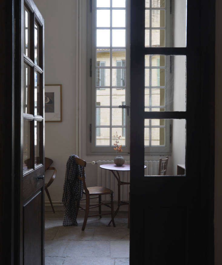 Second Act A London Design Couples Townhouse in a Small French Market Town A peek into a quiet corner, anchored by a French garden table, in the office.
