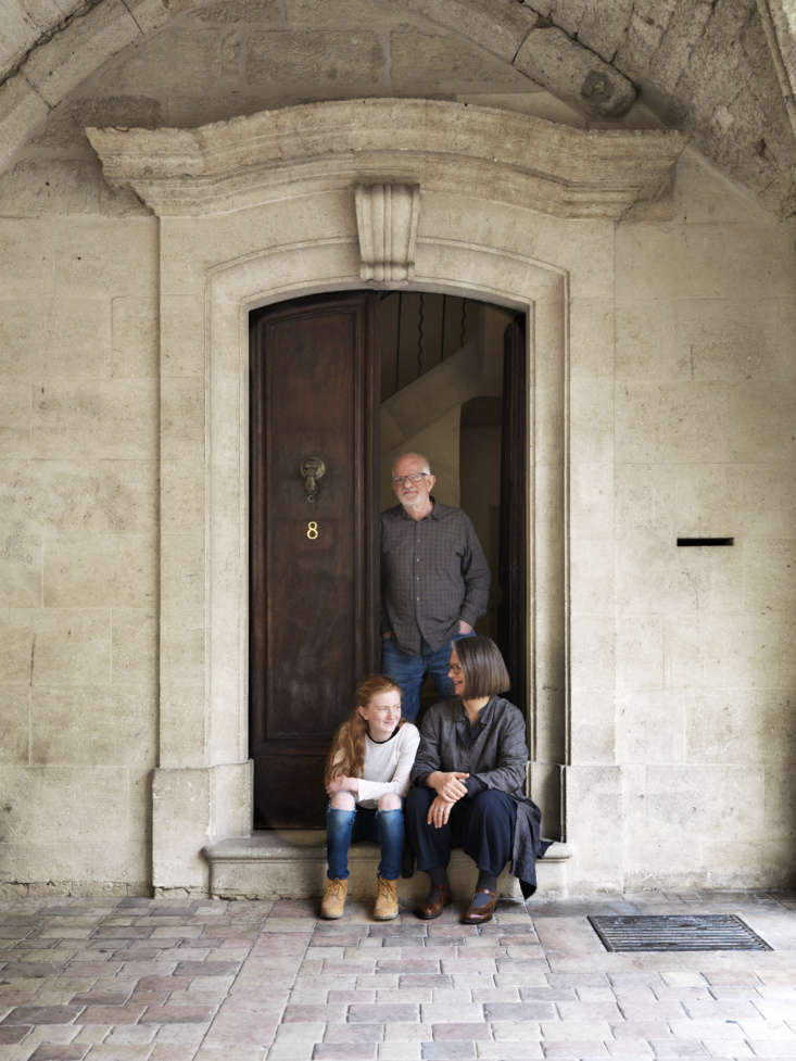 Second Act A London Design Couples Townhouse in a Small French Market Town Lone and Chris McCarter with their granddaughter, Lily, on the front step of their home.