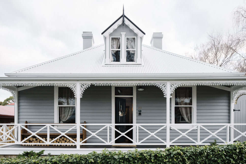 The cottage exterior—with gingerbread Victorian charm intact. &#8