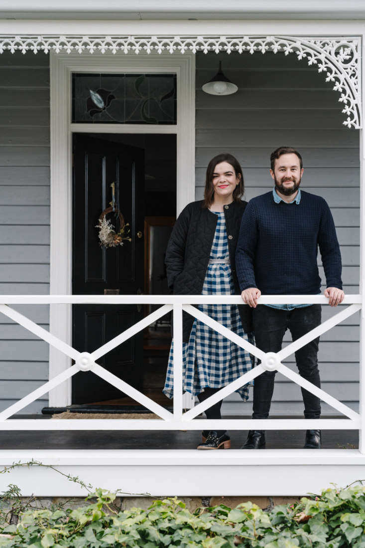 the couple on the front porch of their home. 25