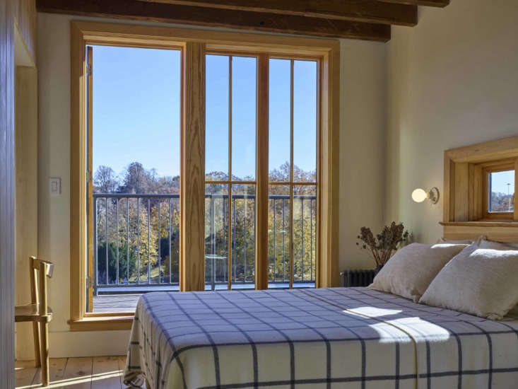 The master bedroom is situated in the 300-square-foot aerie. The windowpane blanket is from L.L. Bean.