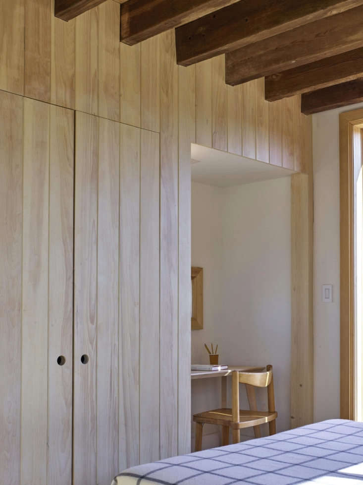 The white pine-paneled closet wall includes a tidy work niche.