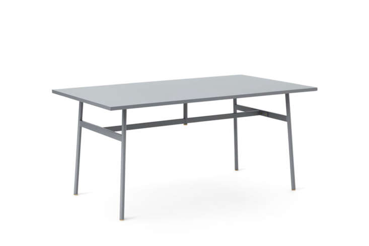 The Normann Copenhagen Union Dining Table is available in grey, black, and white starting at $loading=