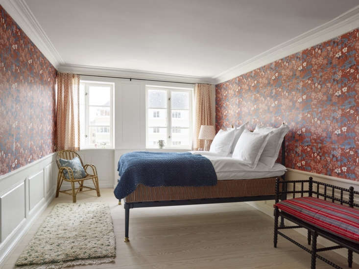 the residence&#8\2\17;s red bedroom is cloaked in a floral pattern by engli 19