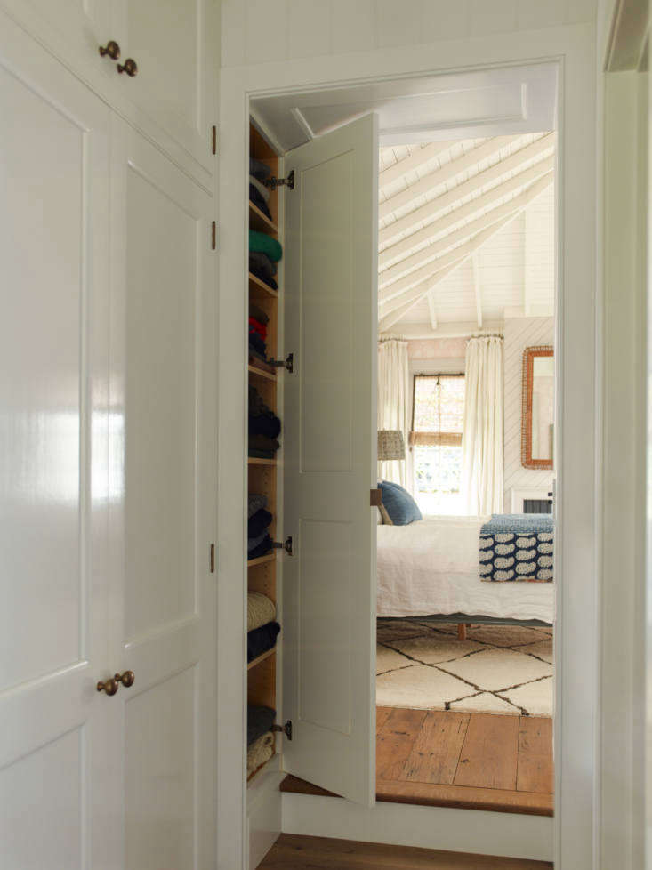 Built-in storage in a hallway. Photo by Eric Piasecki.