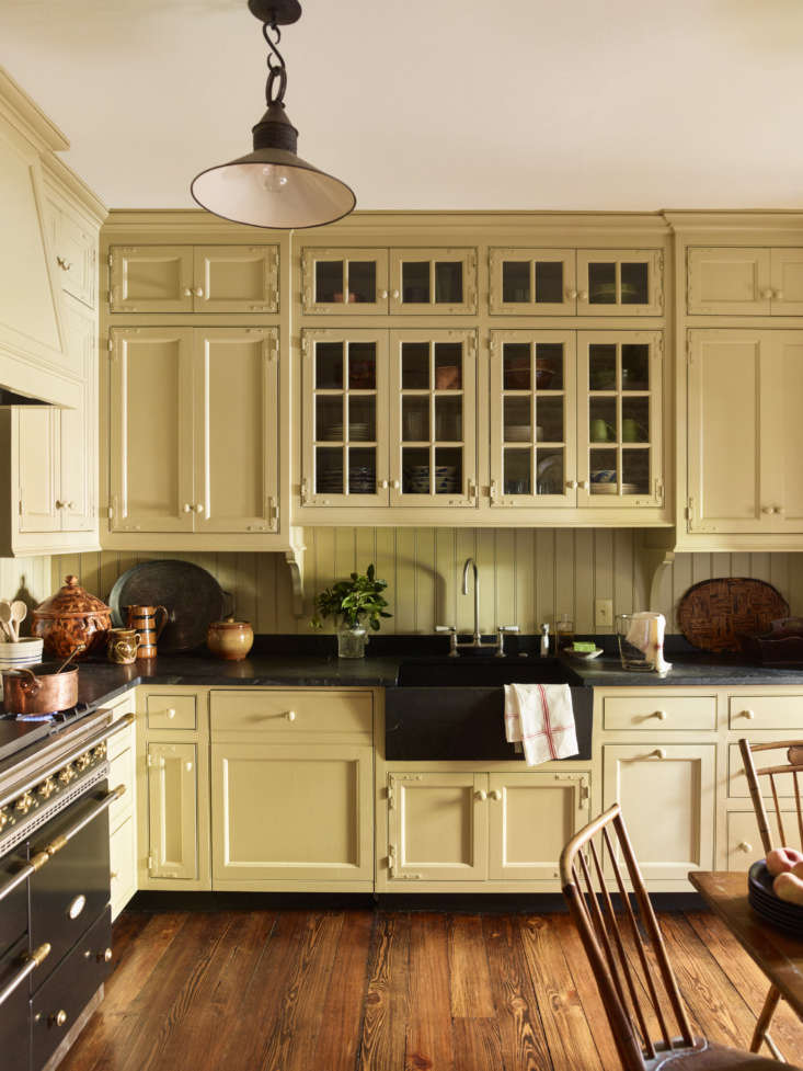 Schafer favors dark stone countertops in the kitchen. Photo by Eric Piasecki.