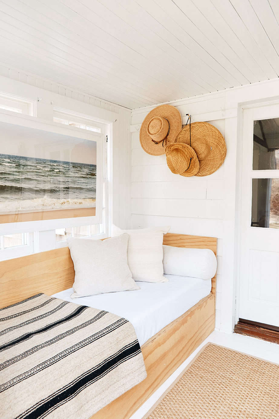 The Donald Judd-inspired plywood daybed was built for his old home but fit nicely here. Above it hangs a photograph of a Cape Cod beach by his friend Barry Balczun.