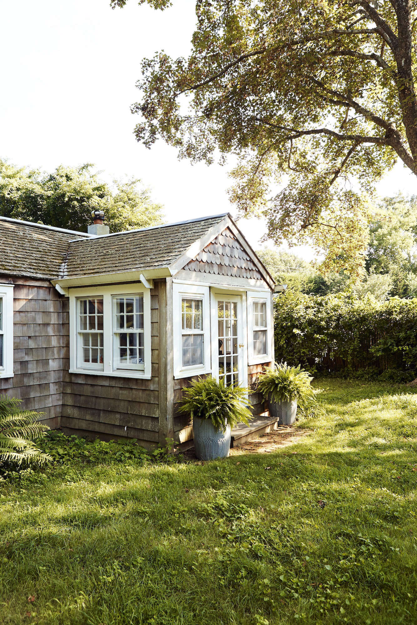 The exterior is clad in classic cedar shingles.