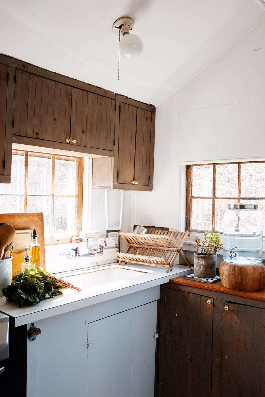 The kitchen, humble and practical, was left untouched.