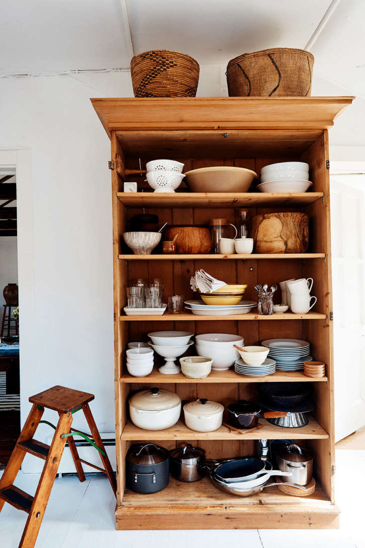 Glenn brought in a large bookcase for more storage in the kitchen. &#8