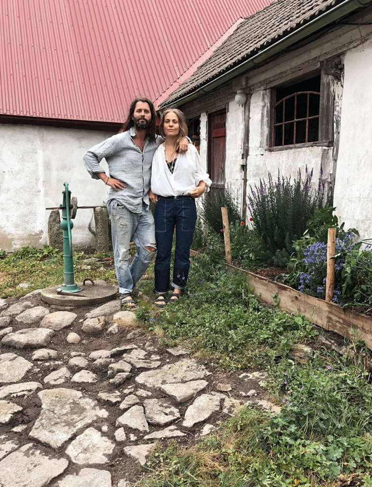 Jacob and Ellen in their back garden. The farmhouse is in the seaside town of Österlen, in the south of Sweden, just over an hour&#8