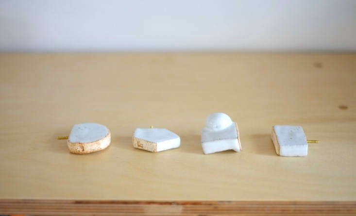 LA-based industrial designer Juliana Hung of Juju Made offers a range of Ceramic Knobs that can be used as hooks; $38.