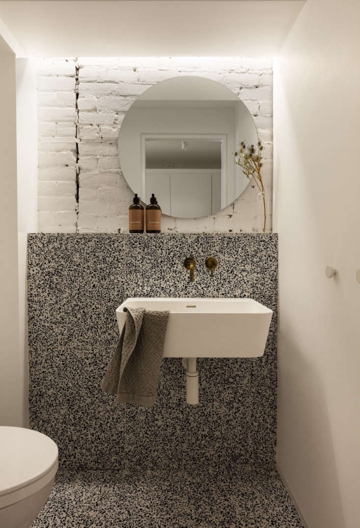 the terrazzo powder room, featuring a sink from porcelanosa. 15